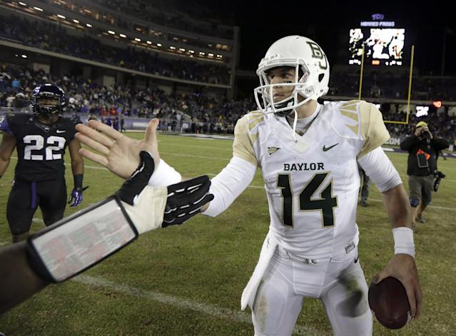 Baylor quarterback Bryce Petty (14) is congratulated after an NCAA college football game against TCU, Saturday, Nov. 30, 2013, in Fort Worth, Texas. Baylor won 41-38. (AP Photo/LM Otero)