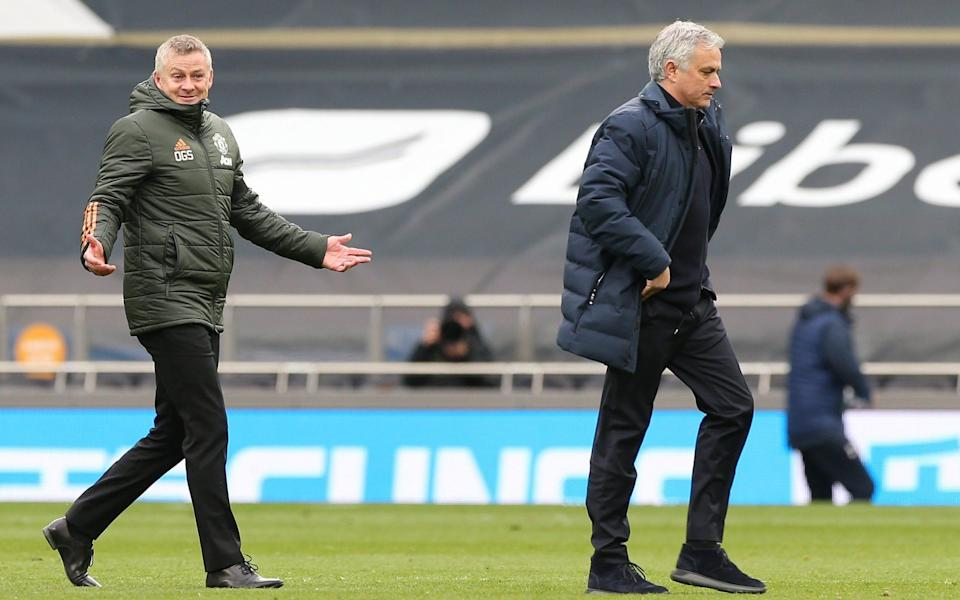 Manager Ole Gunnar Solskjaer of Manchester United walks off with Manager Jose Mourinho of Tottenham Hotspur after the Premier League match between Tottenham Hotspur and Manchester United at Tottenham Hotspur Stadium on April 11, 2021 in London, England.  - GETTY IMAGES