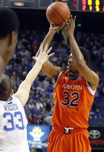 Auburn's Noel Johnson, right, shoots under pressure from Kentucky's Kyle Wiltjer during the first half of an NCAA college basketball game at Rupp Arena in Lexington, Ky., Saturday, Feb. 9, 2013. (AP Photo/James Crisp)