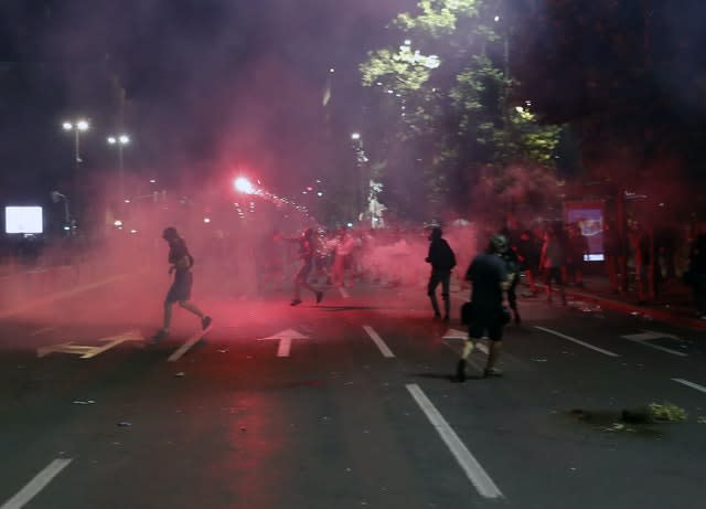 Hundreds of demonstrators tried to storm Serbia's parliament on Friday