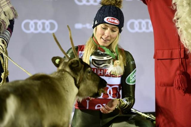 Mikaela Shiffrin won a fourth reindeer at Levi and fed it lichen at the presentation (AFP Photo/Martti Kainulainen)