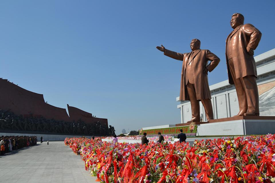 The colossal bronzes of the Great Leader Kim Il-sung and Dear Leader Kim Jong-il are 65 feet high. They make us feel like ants. On almost every day of this tour, we are asked to pay our respects by lining up and bowing before a statue of the Great Leader. To refuse would be awkward, as it risks getting our two guides into trouble.