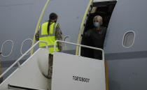 A crew member opens the door of an RAF Voyager aircraft carrying members of the British armed forces 16 Air Assault Brigade after landing at Brize Norton, England, as they return from helping in operations to evacuate people from Kabul airport in Afghanistan, Saturday, Aug. 28, 2021. More than 100,000 people have been safely evacuated through the Kabul airport, according to the U.S., but thousands more are struggling to leave in one of history's biggest airlifts. (AP Photo/Alastair Grant, Pool)