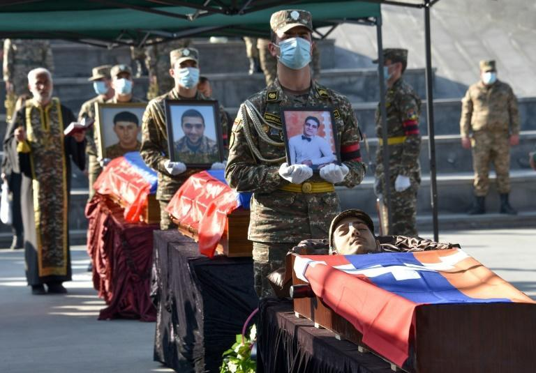 Armenian soldiers carried the coffins of soldiers killed during the military conflict at Yerablur Military Memorial Cemetery in Yerevan