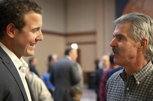 Chicago Cubs first baseman Anthony Rizzo, left, visits with former Cubs first baseman Bill Buckner during the opening night of the baseball team's fan convention in Chicago on Friday, Jan. 12, 2018. (Patrick Kunzer/Daily Herald via AP)