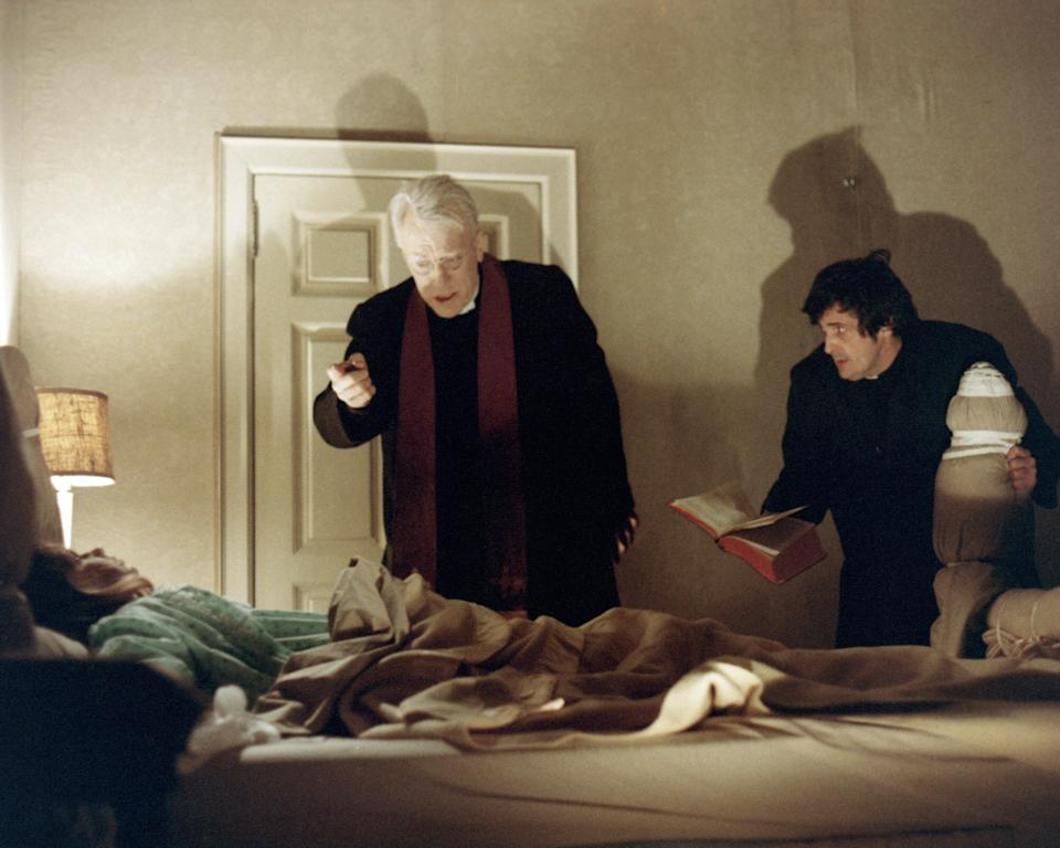 Left to right: American actress Linda Blair as Regan MacNeil, Swedish actor Max von Sydow as Father Lankester Merrin, and American actor Jason Miller (1939 - 2001) as Father Damien Karras in 'The Exorcist', directed by William Friedkin, 1973. (Photo by Silver Screen Collection/Getty Images)