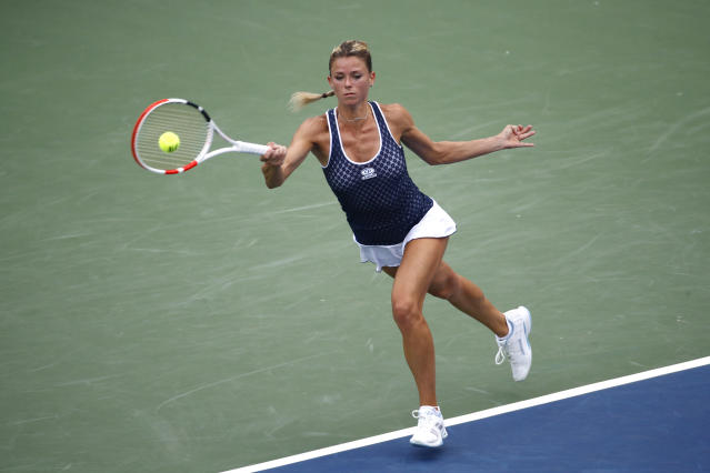 Camila Giorgi, of Italy, returns the ball during a semifinal match against Caty McNally at the Citi Open tennis tournament, Saturday, Aug. 3, 2019, in Washington. (AP Photo/Patrick Semansky)
