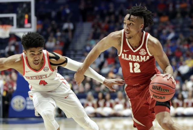 Alabama guard Dazon Ingram (12) drives against Mississippi guard Breein Tyree (4) in the first half of an NCAA college basketball game at the Southeastern Conference tournament Thursday, March 14, 2019, in Nashville, Tenn. (AP Photo/Mark Humphrey)