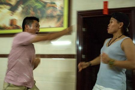 Huang Wensi play-fights with her brother-in-law at home in Lianjiang, Guangdong province, China, June 30, 2018. REUTERS/Yue Wu