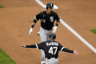 Chicago White Sox's Jake Lamb (23) gets congratulated by third base coach Joe McEwing following his solo home run off Minnesota Twins pitcher Bailey Ober in the first inning of a baseball game Tuesday, May 18, 2021, in Minneapolis. (AP Photo/Jim Mone)
