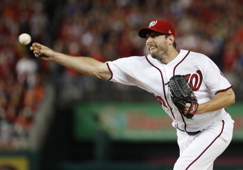 Max Scherzer's workload makes him the slight favorite over Clayton Kershaw for NL Cy Young. (AP)