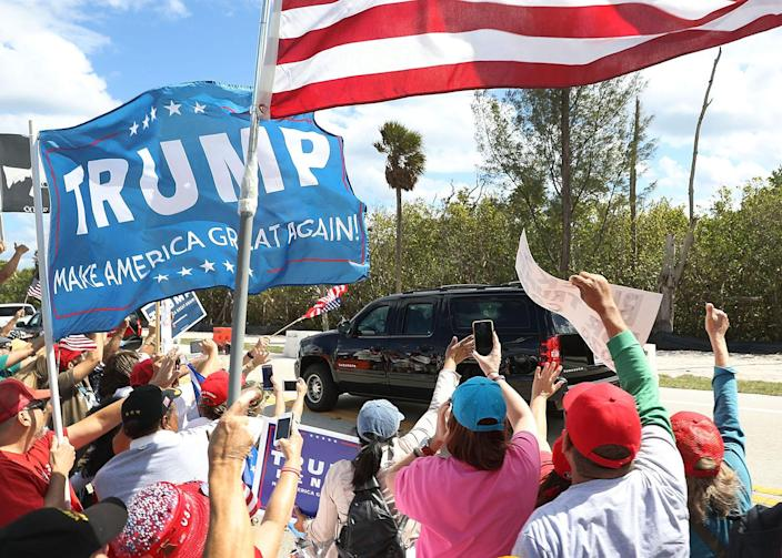 <p>A limousine transporting President Donald Trump is driven past supporters near his Mar-a-Lago resort home in West Palm Beach, Fla., March 4, 2017. (Photo: Joe Raedle/Getty Images) </p>