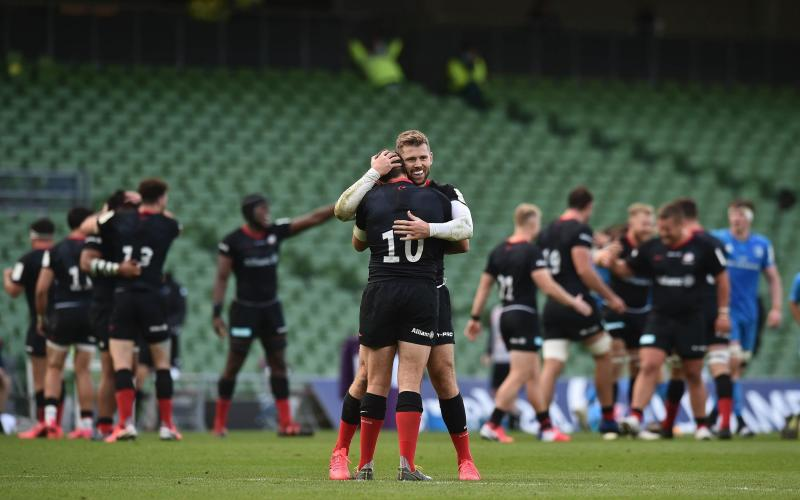 Alex Goode and Eliot Daly of Saracens celebrate after the Heineken Champions Cup Quarter Final match between Leinster and Saracens at Aviva Stadium on September 19, 2020 in Dublin, Ireland. - GETTY IMAGES