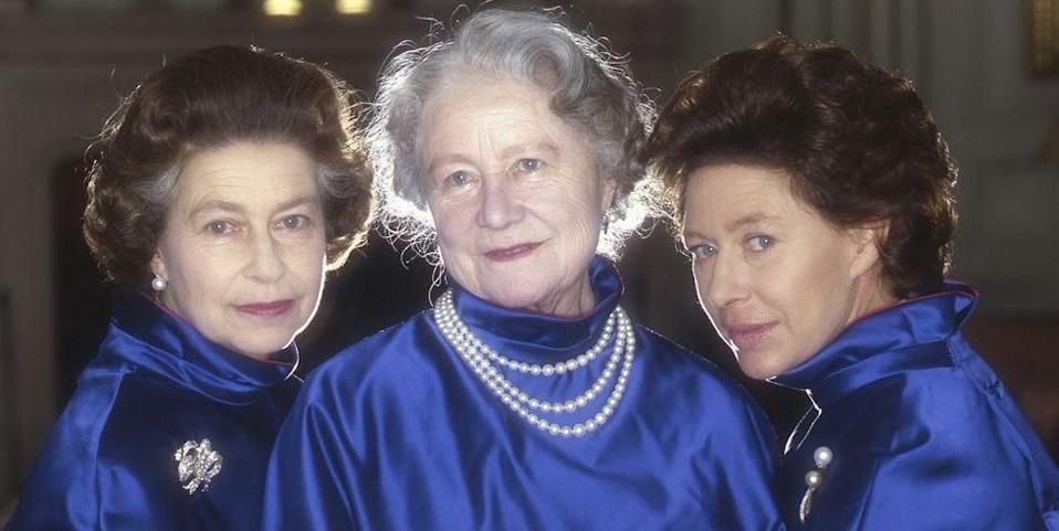 """<p>Queen Elizabeth II, her mother, and Princess Margaret pose for an official portrait in matching cobalt satin jackets. Nearly two decades later, in 2002, Margaret and the Queen Mother <a href=""""https://www.theguardian.com/uk/2002/mar/30/queenmother.monarchy10"""" rel=""""nofollow noopener"""" target=""""_blank"""" data-ylk=""""slk:passed away"""" class=""""link rapid-noclick-resp"""">passed away</a> less than a month apart from each other.</p><p>Elizabeth II and her sister had a close-knit relationship and """"a love, friendship, and conspiracy that were impressive to behold,"""" according to <em><a href=""""https://www.vanityfair.com/style/2016/04/queen-elizabeth-princess-margaret-sisters-bond"""" rel=""""nofollow noopener"""" target=""""_blank"""" data-ylk=""""slk:Vanity Fair"""" class=""""link rapid-noclick-resp"""">Vanity Fair</a></em>. Margaret reportedly had a direct phone line at Kensington Palace to her older sister, which she'd often use to chat and gossip with her sibling.</p>"""