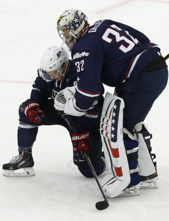 U.S. team players Matt Grzelcyk and Jon Gillies (R) react after their loss to Russia in their IIHF Ice Hockey World Championship quarter-final match in Malmo, Sweden, January 2, 2014. REUTERS/Alexander Demianchuk (SWEDEN - Tags: SPORT ICE HOCKEY)