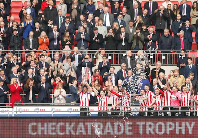 "Soccer Football - Checkatrade Trophy Final - Lincoln City vs Shrewsbury Town - Wembley Stadium, London, Britain - April 8, 2018 Lincoln City's Luke Waterfall lifts the trophy after winning the Checkatrade Trophy Action Images/Andrew Boyers EDITORIAL USE ONLY. No use with unauthorized audio, video, data, fixture lists, club/league logos or ""live"" services. Online in-match use limited to 75 images, no video emulation. No use in betting, games or single club/league/player publications. Please contact your account representative for further details."