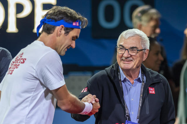 Team Europe, Roger Federer, left, shake hands with his father Robert Federer, right, during a training session for the Laver Cup in Geneva, Switzerland, Thursday, Sept. 19, 2019. The competition will pit a team of the best six European players against the top six from the rest of the world. The Laver Cup edition is scheduled for Sept. 20-22, 2019 at the Palexpo in Geneva. The Cup is named after the Australian tennis legend Rod Laver. (Martial Trezzini/Keystone via AP)