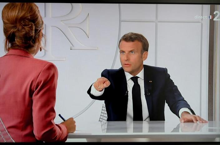 "Emmanuel Macron revived a traditional Bastille Day presidential interview, during which he vowed a ""massive"" coronavirus recovery plan (AFP Photo/Ludovic Marin)"