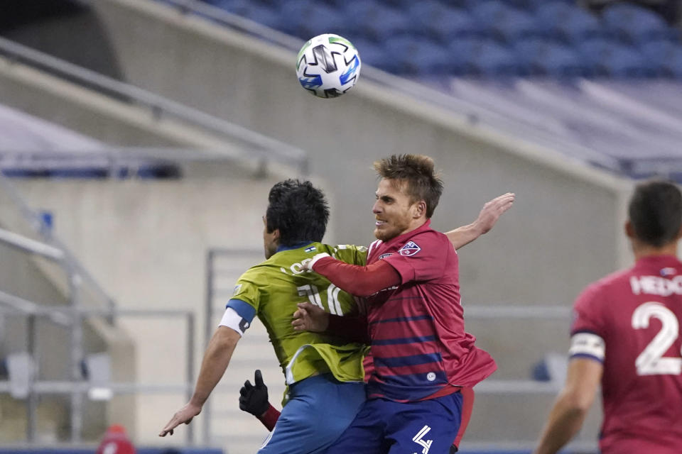 FC Dallas defender Bressan, right, and Seattle Sounders midfielder Nicolas Lodeiro vie for the ball during the second half of an MLS playoff soccer match Tuesday, Dec. 1, 2020, in Seattle. (AP Photo/Ted S. Warren)