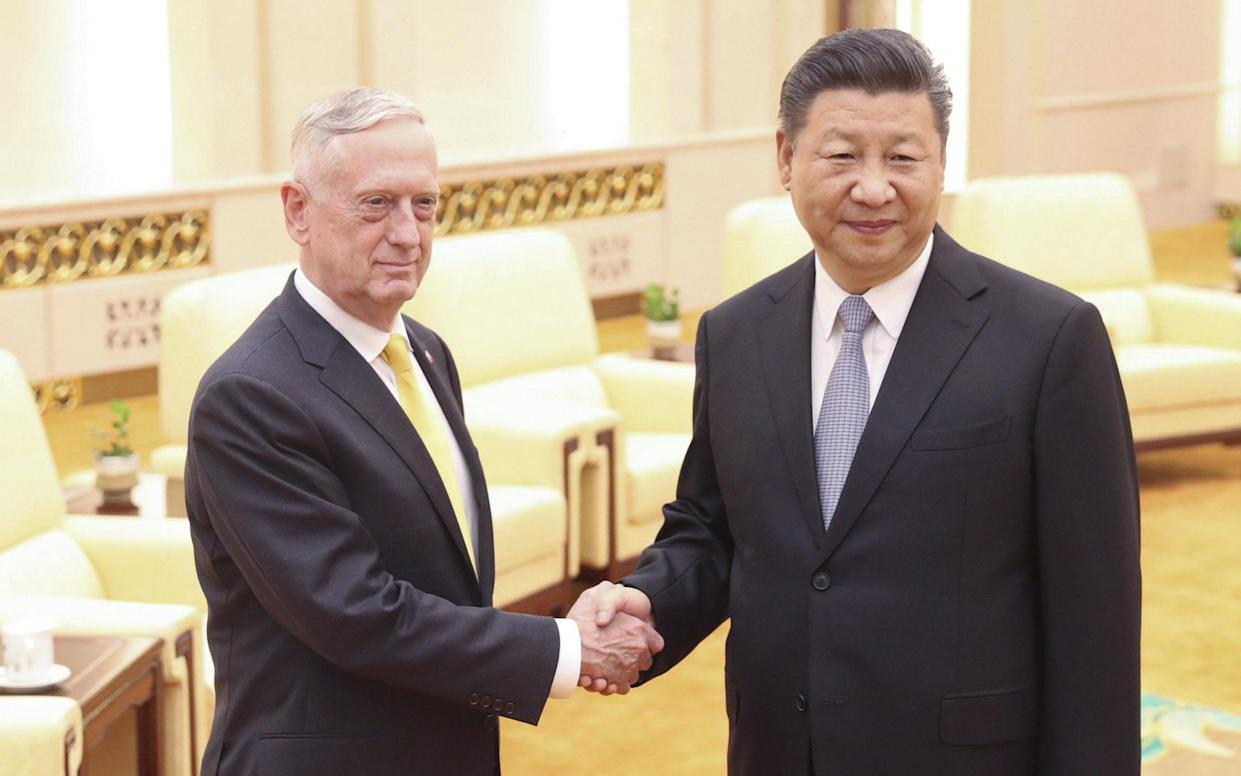PresidentXiJinpingtold James Mattis, theUSDefence Secretary, that China wouldn't give up any territory that China considered its own - Visual China Group