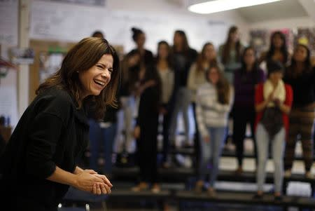 Opera singer Ana Maria Martinez laughs during a visit with students at Lake View High School in Chicago, Illinois, October 22, 2014. REUTERS/Jim Young