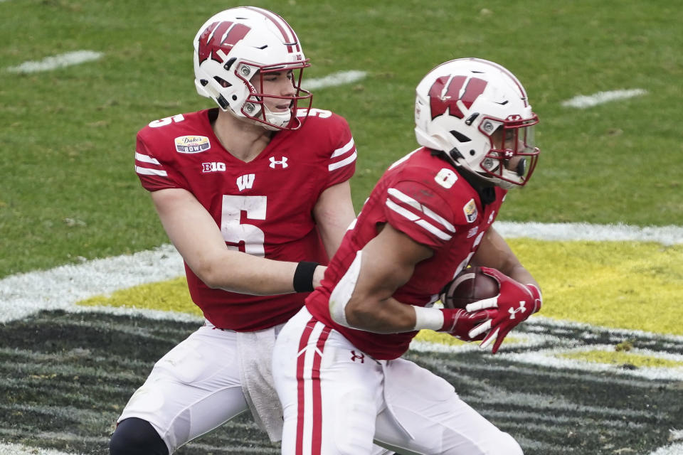 Wisconsin's Graham Mertz provides sign of times with trademarked logo