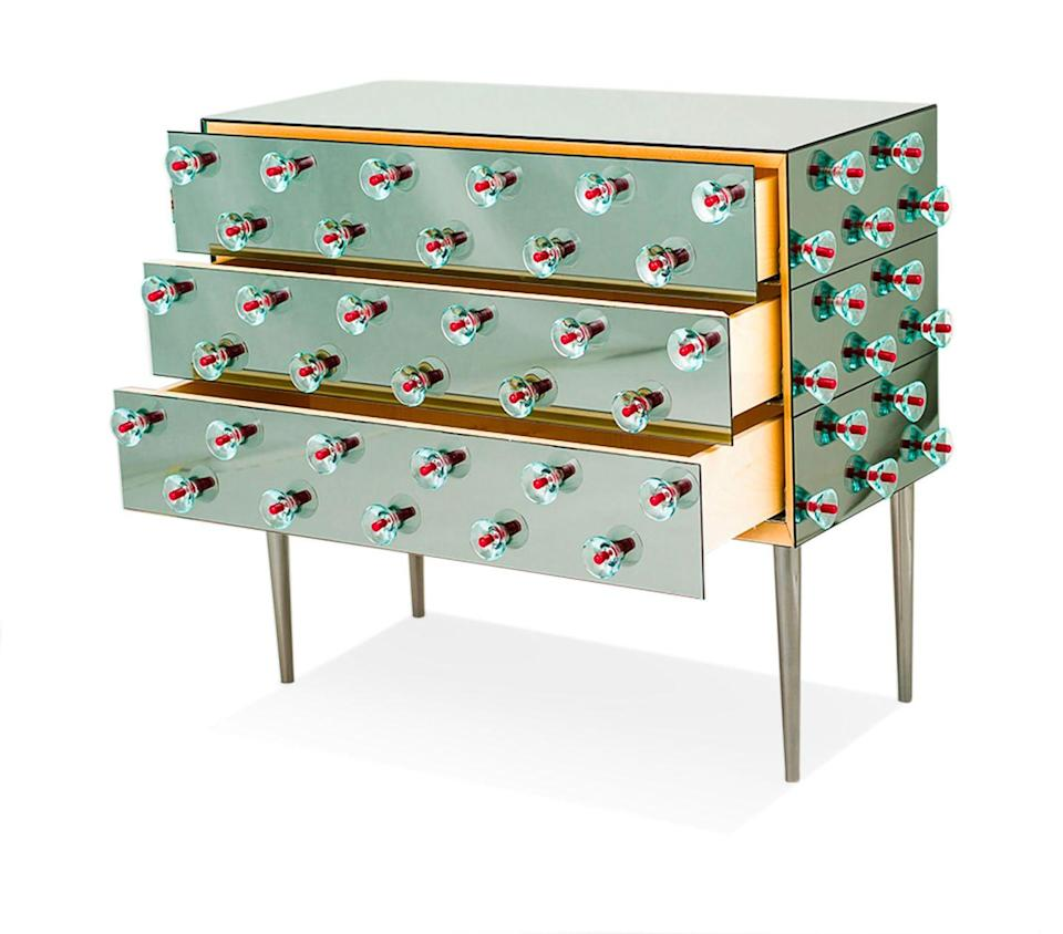 """<p><strong>JL:</strong> Quintessentially Italian with an air of femininity. It takes someone with real confidence to pull this off. </p><p><strong>JH:</strong> So glamorous. It's a modern art piece as a cabinet. I would flank a fireplace with a pair of these.</p><p><em>38"""" w. x 17"""" d. x 32"""" h.; price upon request. <a href=""""https://nilufar.com/en/"""" rel=""""nofollow noopener"""" target=""""_blank"""" data-ylk=""""slk:nilufar.com"""" class=""""link rapid-noclick-resp"""">nilufar.com</a></em></p>"""