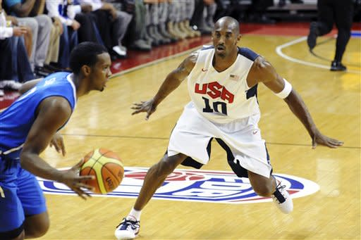 In this photo provided by the Las Vegas News Bureau, United States Olympic men's basketball team member Kobe Bryant (10) guards Dominican Republic's Gerardo Suero during an exhibition game, Thursday, July 12, 2012, in Las Vegas. The U.S. won 113-59. (AP Photo/Las Vegas News Bureau, Brian Jones)