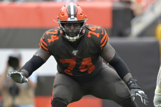 FILE - In this Sept. 8, 2019, file photo, Cleveland Browns offensive tackle Chris Hubbard (74) blocks in the second half of an NFL football game against the Tennessee Titans in Cleveland. Hubbard agreed to rework his contract after the team signed free agent Jack Conklin, a person familiar with the deal told The Associated Press on Thursday, March 26, 2020. (AP Photo/David Richard, File)