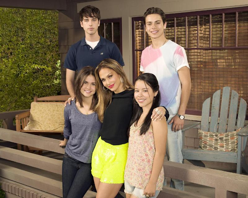 """This undated image released by ABC Family shows, from row from left, Maia Mitchell, executive producer Jennifer Lopez, Cierra Ramirez, from back left, David Lambert and Jake T. Austin from """"The Fosters,"""" premiering June 3 on ABC Family. (AP Photo/ABC Family, Bob D'Amico)"""