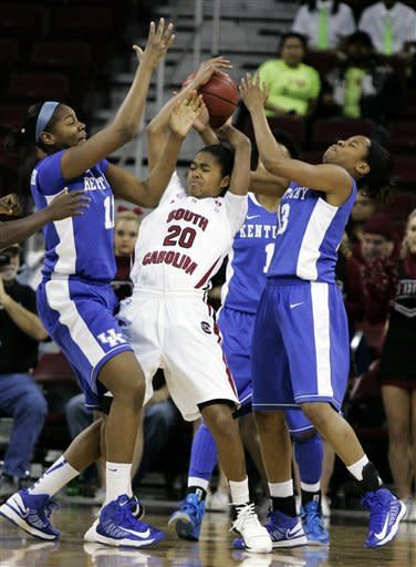 Kentucky's DeNesha Stallworth (11) and Bria Goss (13) force a turnover from South Carolina's Sancheon White (20) during the first half of their NCAA college basketball game, Thursday, Jan. 24, 2013, in Columbia, S.C. (AP Photo/Mary Ann Chastain)