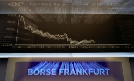 The German share prize index DAX board is photographed early afternoon on the day of the Brexit deal vote of the British parliament in Frankfurt, Germany, January 15, 2019. REUTERS/Kai Pfaffenbach/Files