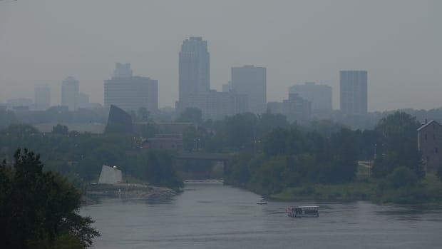 The Gatineau, Que., skyline is obscured by a hazy smog as smoke from fires burning in northwestern Ontario and Manitoba filled the air on Monday. (Ian Black/CBC News - image credit)
