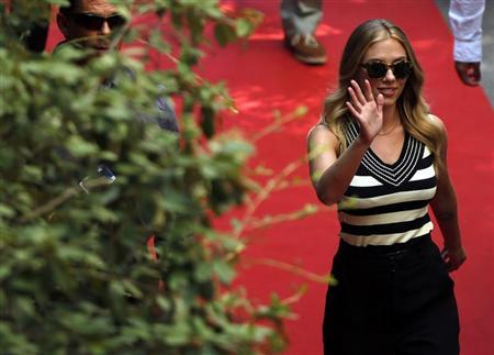 "Actress Johansson waves as she arrives for a news conference for the movie ""Under the Skin"", directed by Glazer, during the 70th Venice Film Festival in Venice"