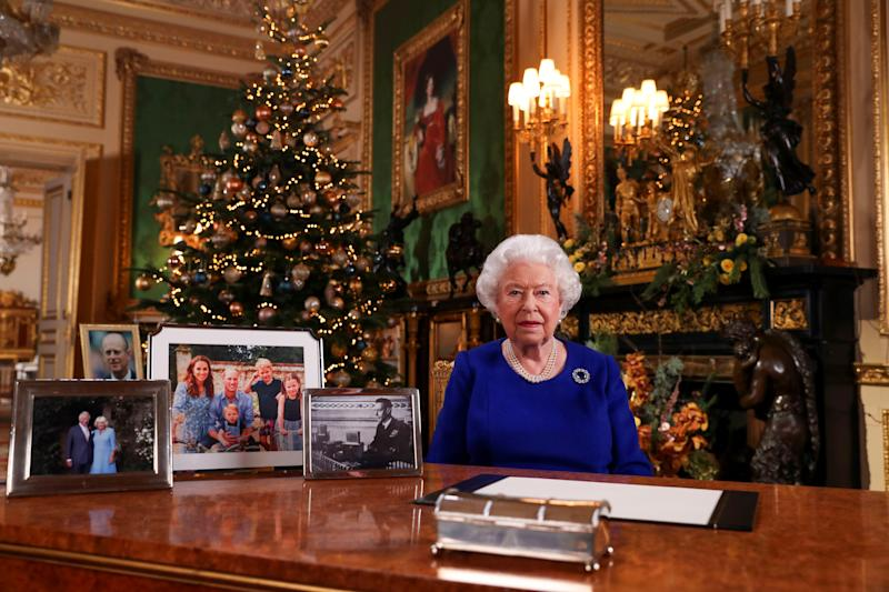 Britain's Queen Elizabeth poses, after recording her annual Christmas Day message in Windsor Castle, in Berkshire, Britain, in this undated pool picture released on December 24, 2019. Steve Parsons/Pool via REUTERS