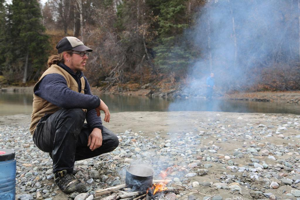 McCarthy, Alaska, USA: Brent Sass sitting by the camp fire.