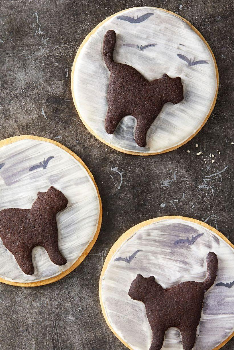 """<p>You'll be really lucky if these <a href=""""https://www.goodhousekeeping.com/food-recipes/a28566904/black-cocoa-cookies-recipe/"""" rel=""""nofollow noopener"""" target=""""_blank"""" data-ylk=""""slk:black cocoa cookie"""" class=""""link rapid-noclick-resp"""">black cocoa cookie</a> cats cross your path at Halloween.</p><p><em><a href=""""https://www.goodhousekeeping.com/food-recipes/party-ideas/a28609114/black-cat-cookies-recipe/"""" rel=""""nofollow noopener"""" target=""""_blank"""" data-ylk=""""slk:Get the recipe for Black Cat Cookies »"""" class=""""link rapid-noclick-resp"""">Get the recipe for Black Cat Cookies »</a></em></p>"""