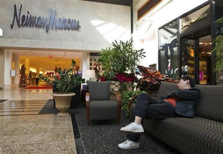 A man sleeps on a couch outside of a Neiman Marcus store at South Park mall in Charlotte