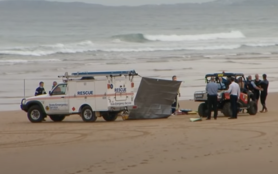 Paramedics and police at Shelly Beach after a man was mauled by a shark.