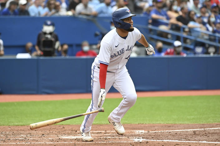 Toronto Blue Jays' Breyvic Valera watches his two-run home run in the fourth inning of a baseball game against the Oakland Athletics in Toronto on Saturday, Sept. 4, 2021. (Jon Blacker/The Canadian Press via AP)