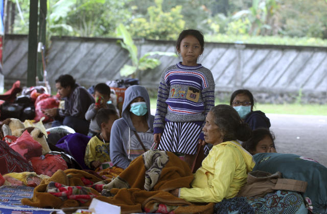 <p>Villagers rest at an evacuee camp in Rendang, Bali, Indonesia, Monday, Sept. 25, 2017. More than 35,000 people have fled a menacing volcano on the Indonesia tourist island of Bali, fearing will erupt for the first time in more than half a century as increasing tremors rattle the region. (AP Photo/Firdia Lisnawati) </p>