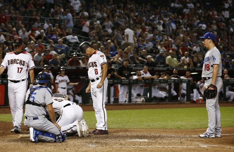 Kershaw, Dodgers beat D-backs 7-4 to maintain NL West lead