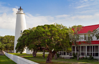 """<p>Where: North Carolina</p><p>North Carolinians call Ocracoke the """"Pearl of the Outer Banks."""" It's a unique little enclave with 16 miles of undeveloped beaches (some stretches allow off-road vehicles), a herd of wild ponies, a lighthouse that's purported to be the oldest on the East Coast, and Ocracoke Village that dates back to the 1880s and is on the National Register of Historic Places. Pirates like Blackbeard once visited these shores that are now home to just shy of a thousand residents. Despite its small size, the island offers accommodations from camping sites to motels and hotels to quaint cottages. Visitors also enjoy a variety of locally owned restaurants and shops.</p><p>Insider Tip: Getting to Ocracoke Island takes a bit of planning. You can take the North Carolina Ferry System to the island from Hatteras (60 minutes), Cedar Island (2 hours and 15 minutes), or Swan Quarter (2 hours and 40 minutes).</p><p><i>(Photo: Keifer 