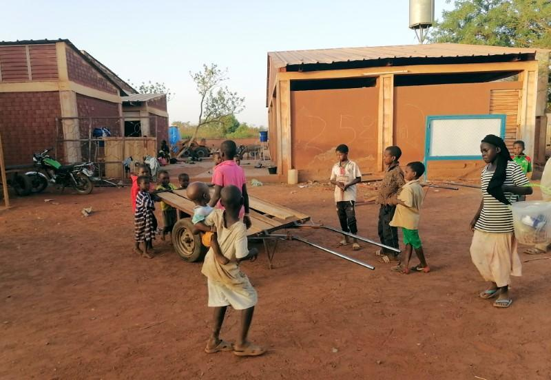 Children play during the visit of the Emir Djibril Diallo, chief negotiator in the talks between the jihadists and the Thiou population, at the displaced camp of Ouahigouya
