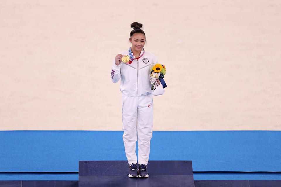 <p>TOKYO, JAPAN - JULY 29: Sunisa Lee of Team United States poses with her gold medal after winning the Women's All-Around Final on day six of the Tokyo 2020 Olympic Games at Ariake Gymnastics Centre on July 29, 2021 in Tokyo, Japan. (Photo by Laurence Griffiths/Getty Images)</p>