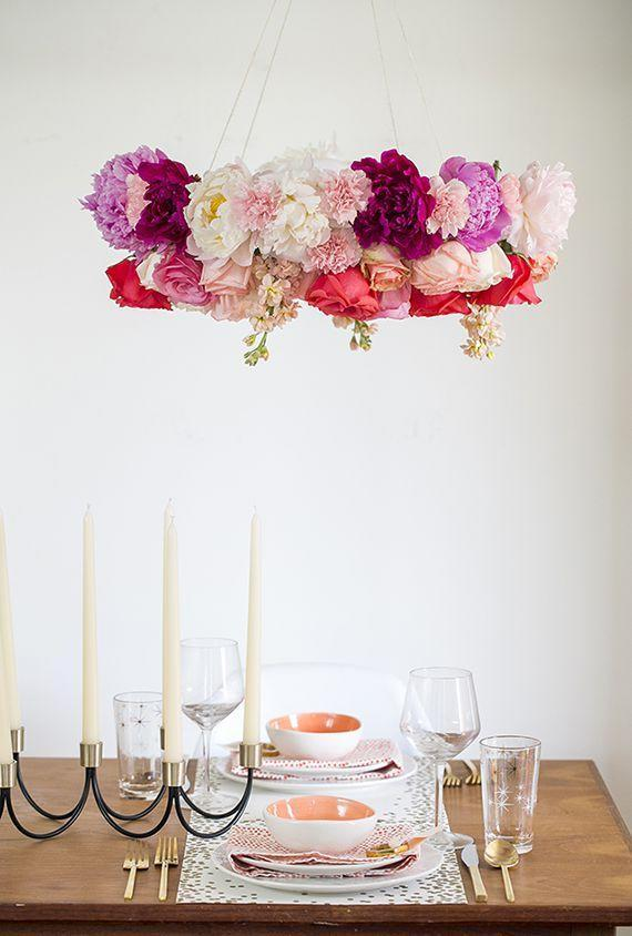 """<p>This flower chandelier will not only elevate your floral game, but will free up table space to make room for the main course. <br></p><p><em><u><a href=""""http://www.100layercake.com/blog/2014/06/11/create-your-own-wedding-florals-with-bloominous/"""" rel=""""nofollow noopener"""" target=""""_blank"""" data-ylk=""""slk:Get the tutorial from 100 Layer Cake »"""" class=""""link rapid-noclick-resp"""">Get the tutorial from 100 Layer Cake »</a></u></em> </p>"""
