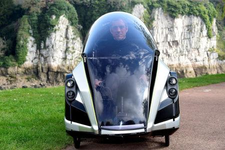 Grant Sinclair, nephew of Sir Clive Sinclair, who developed an electric tricycle in the 1980s, inside his invention, the Iris E-Trike electric tricycle, Chepstow, Wales,
