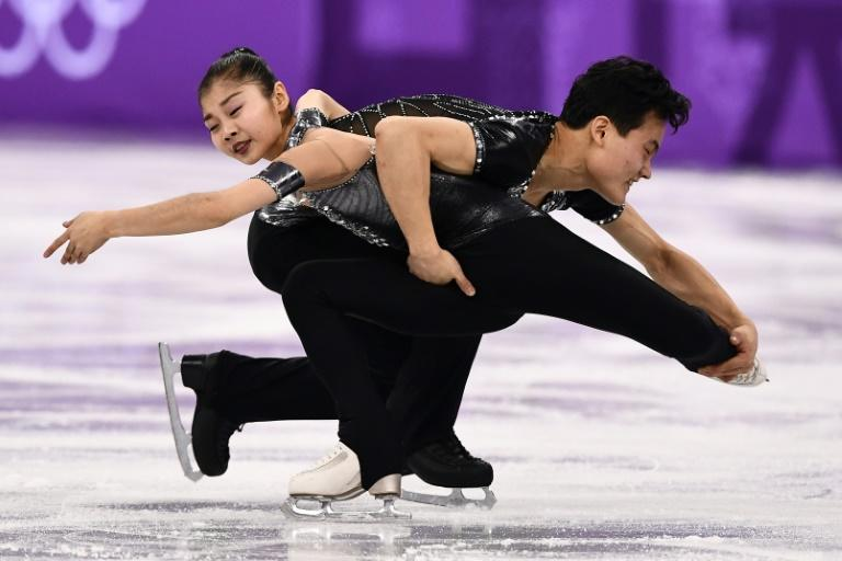 """North Korea's Ryom Tae Ok (L) and Kim Ju Sik seduced the supportive crowd on their Games debut with an excellent execution of their short programme to the Beatles classic """"A Day in the Life"""""""
