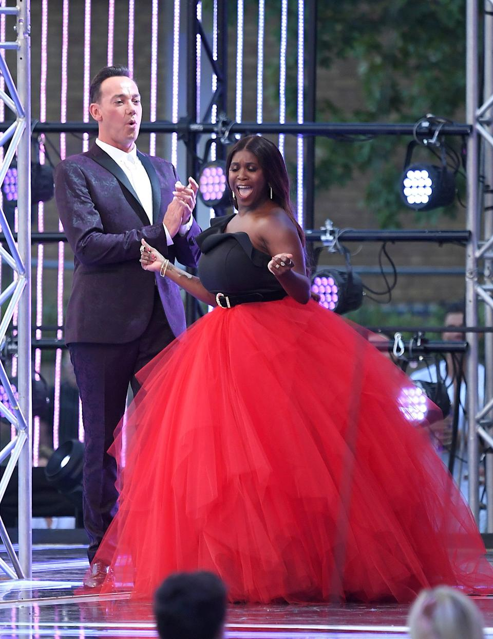 """LONDON, ENGLAND - AUGUST 26: Judges Craig Revel Horwood and Motsi Mabuse attend the """"Strictly Come Dancing"""" launch show red carpet arrivals at Television Centre on August 26, 2019 in London, England. (Photo by Karwai Tang/WireImage)"""