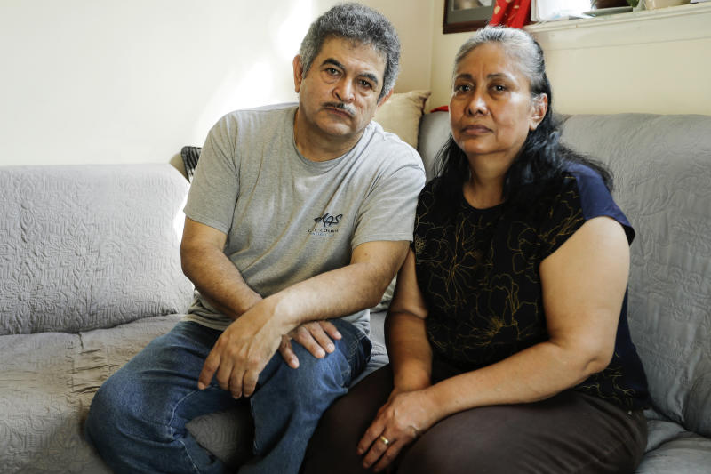 """In this Thursday, June 4, 2020, photo, Francisco Flores, left, poses for a portrait with his wife Livia Herrera in New York. When his brother Crescencio Flores died of coronavirus in New York, his parents back in Mexico asked for one thing: that their son be sent home for burial. So far, his efforts have been in vain. """"I am trying to do this because my parents, 85 and 87 years old, live there,"""" Francisco Flores said. """"They are rooted in their customs. They want a Christian burial for the remains of their son."""" (AP Photo/Frank Franklin II)"""